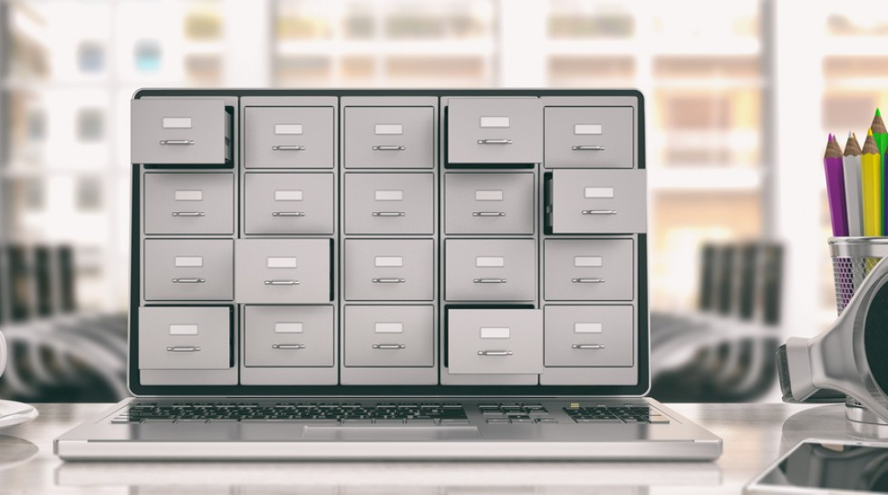 Laptop data storage. Filing cabinet on a laptop screen
